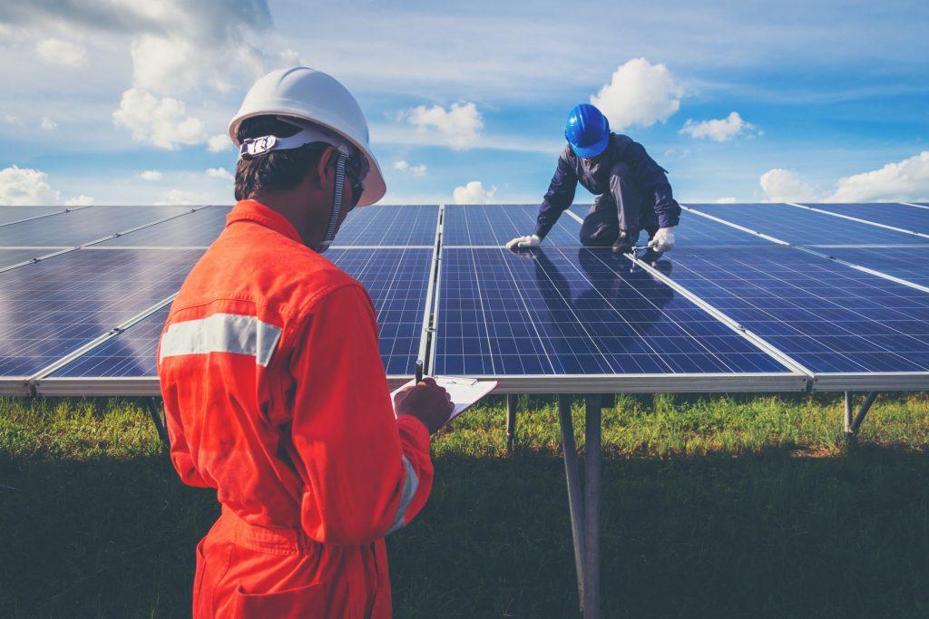 Man on solar panels installing in farm - Northmore Gordon