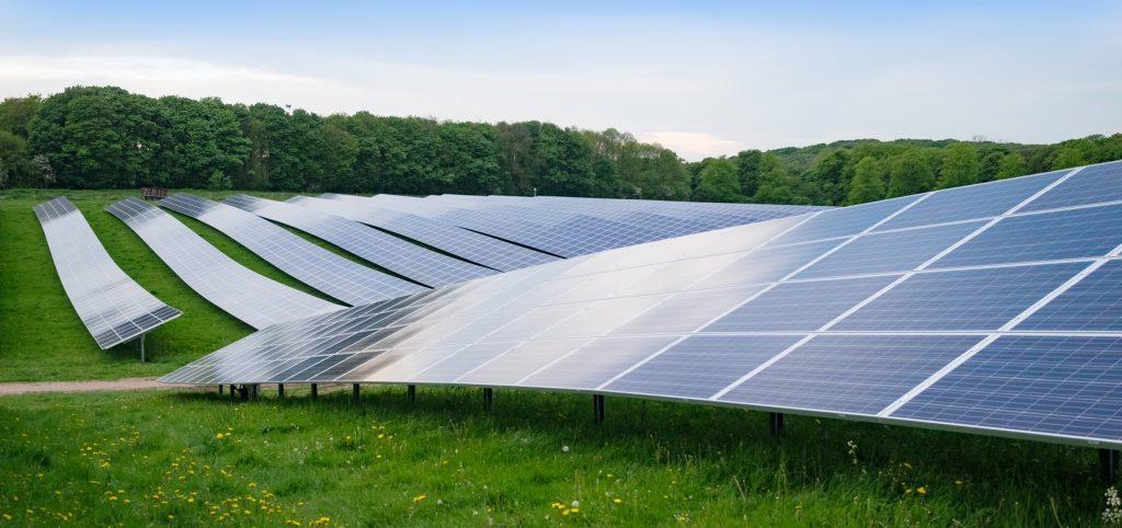 Solar Farm in UK with panels in green field - Northmore Gordon